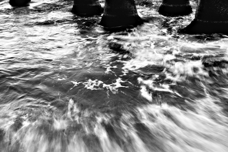 breakwaters: Cement breakwaters by the Black Sea. Black and white image.