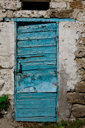 old shabby door with faded paint outdoors photo