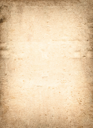 tearing down: very old brown paper background with space for text or image