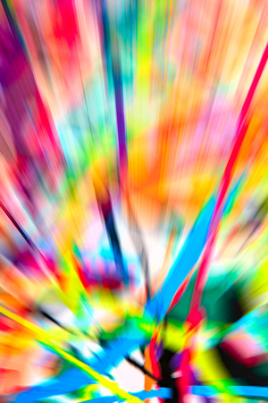 versicolor: Abstract multicolored background. Colorful radial blur, streaks of light, sunburst or starburst. Rays of versicolor light. Digitally generated image. Acrylic painting with a zoom effect.