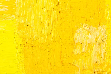 yellow: abstract wallpaper, texture, background of close-up fragment of oil painting on canvas with brush strokes.