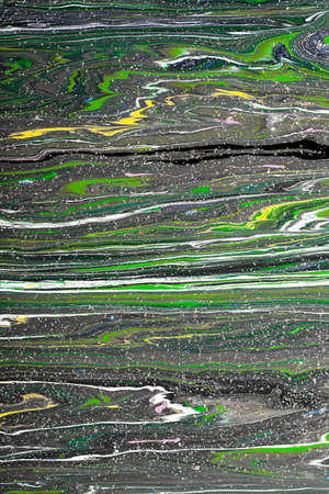 Closeup view of an original painting. Multicolored texture with space for text or image. Fragment of artwork, modern art, contemporary art. Mixed media. Avant-garde art. Stains, spray paint.