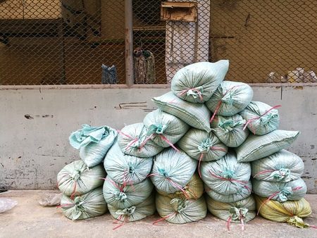 Stack of sandbags for construction worker to build the wall Stock Photo