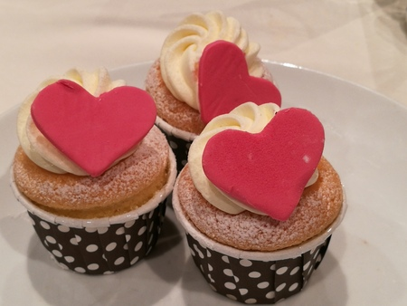 sugarpaste: Homemade Vanilla Buttercream cupcake decorate with heart sugarpaste or marzipan Stock Photo