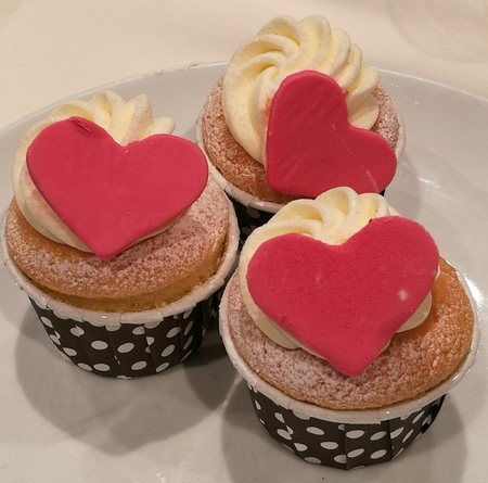 sugarpaste: Homemade Vanilla Buttercream cupcake decorate with heart sugarpaste or marzipan, closed up shot