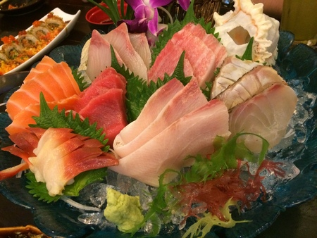 Special Deluxe Combination sashimi set Salmon, Tuna, maguro, otoro, Hotate, Scallop, Kanpachi, Amberjack, Sea Bass, Sea Bream, Mackerel and seaweed on ice sever with wasabi, traditional Japanese food Standard-Bild