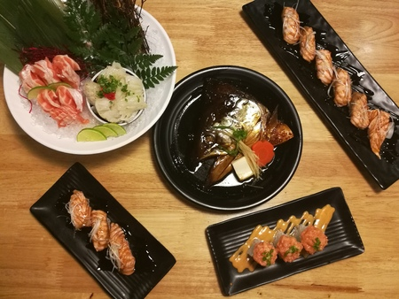 hotate: Special Japanese meal, variety of sushi, Salmon head, Salmon sushi, Salmon sashimi ,top view in the garden