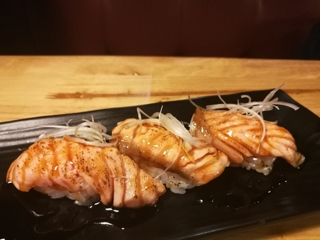 hotate: Salmon Sushi with a little burn on top, raw food, traditional Japanese food