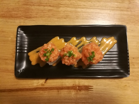hotate: Fusion salmon sushi, stuff with cucumber, crab stick and mango,  Stylist food, top view