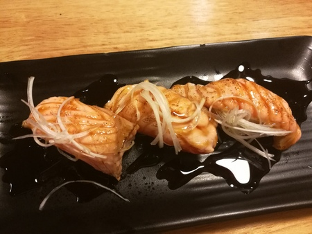 hotate: Salmon Sushi with a little burn on top, raw food, traditional Japanese food, top view