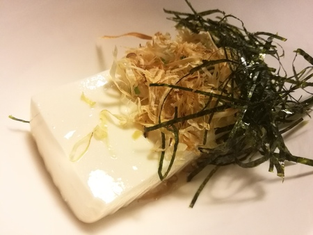 Cold tofu with seaweed and dry fish in a local restaurant, traditional Japanese food, appetizer dish, closed up