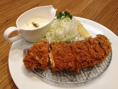 tradional: Deep-fried pork served with slice cabbage, lemon and mayonnaise or tartar sauce in restaurant, Pork cutlet set, Japanese pork Tonkatsu, closed up