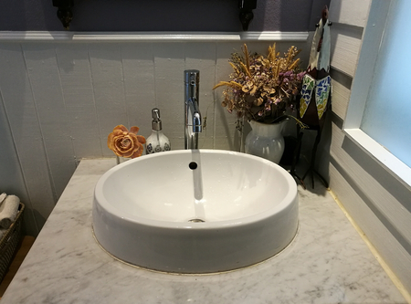 White Sink on marble and napkin in bathroom at restaurant, washstand bathroom in hotel, classical washbasins
