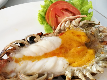 Delicious grilled jumbo giant freshwater river prawns  with melted orange head oil at seafood restaurant in Thailand, Grilled Giant River Prawn, Thai grill seafood, closed-up shot Stock Photo