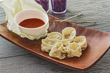 nepali: Vegetable Momos with hot sauce