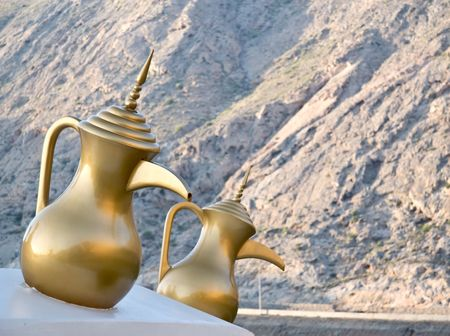 east espresso: Models of Omani coffee pots, on the way to Al Bustan Palace, Muscat, Oman Stock Photo
