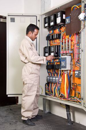 Electrician checking circuit panel Stock Photo - 3348790