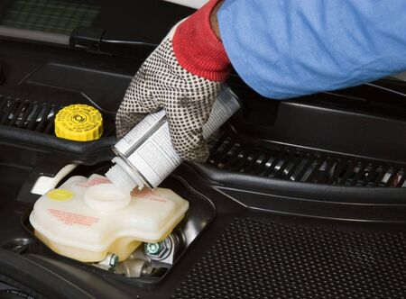 coolant: Mechanic Filling Fluids In A Car