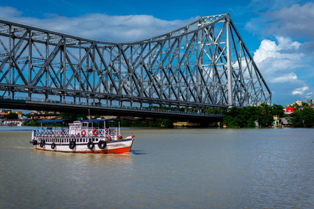 Howrah Bridge is a bridge with a suspended span over the Hooghly River in West Bengal Stock Photo