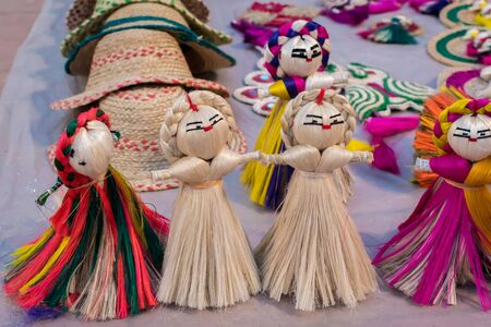 Colourful decorative wall hangings, dolls made of jute, handicrafts for sale (Selective Focus) Standard-Bild