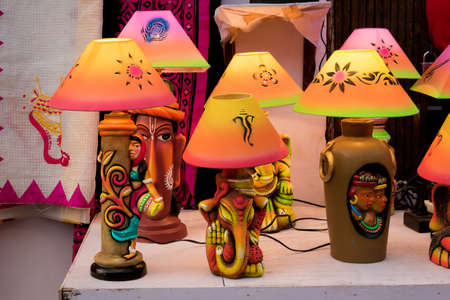 Handmade illuminated decorative table lamps is displayed in a street shop for sale. Indian handicraft and art Standard-Bild