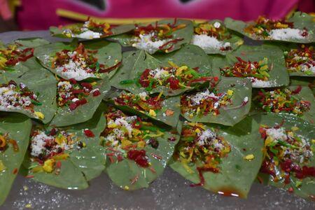 banarasi pan, betel nut garnished with all indian banarasi ingredients for sale (Selective Focus)