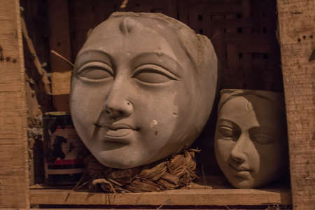 Clay idol face of Goddess Durga, under preparation for