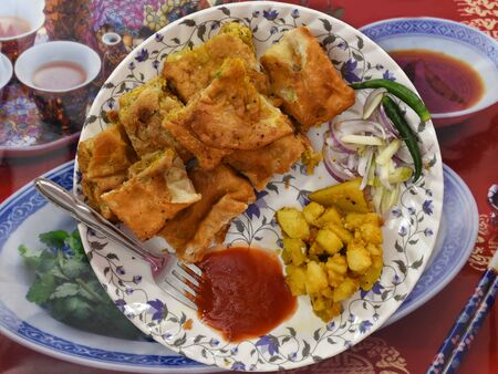 Mughlai paratha is a popular Bengali street food, soft fried bread enhanced by a stuffing of keema, egg, onions and pepper; or a paratha stuffed with the same or similar ingredients.