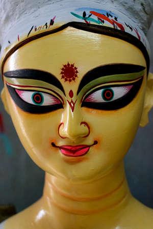 Close up shot of clay idol of Goddess Devi Durga, before upcoming Durga Puja at a potter's studio in Kolkata. Stock Photo