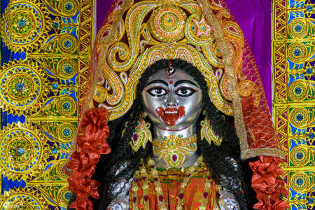 Goddess Kali idol decorated at Puja pandal, Kali puja also known as Shyama Puja or Mahanisha Puja, is a festival dedicated to the Hindu goddess Kali, celebrated on the new moon day in West Bengal.