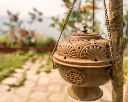 Metal Dhoop Batti Stand Hanging on a tree branch