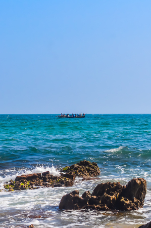 Photograph of Rowing Boat in Sea taken from a distance during Christmas Holiday or New Year celebration time in landscape style Use for background website banner usage Travel vacation holiday concept Stock Photo