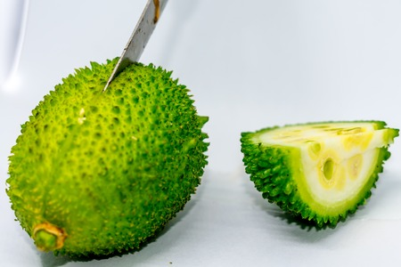 Gac fruit, Jackfruit, Spiny Bitter Gourd, Sweet Grourd or Cochinchin Gourd. Natural gac fruit in the garden, Gac, Baby Jackfruit, Sweet Gourd, Cochinchin , Momordica cochinchinensis. White background Stock Photo