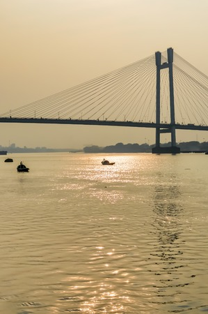 View of second Hooghly Bridge Kolkata India taken at dusk, at dawn, at daytime in landscape style.