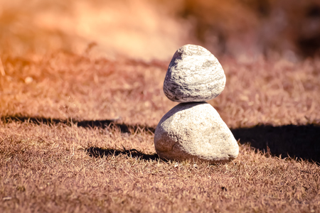 Heap of white stone stack of rock decoration in vertical style composition, copy space. Harmony, stability, strength, well being, concept. Useful in health, spa-therapy, alternative, medicine industry 写真素材