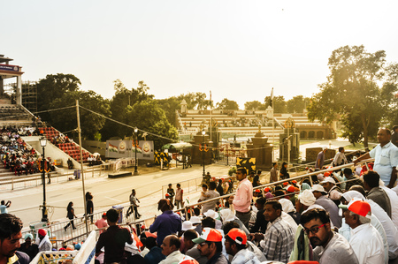 WAGHA BORDER, AMRITSAR, PUNJAB, INDIA - JUNE, 2017. People enjoying the lowering of flags ceremony. Its a daily military practice security forces of India and Pakistan jointly followed since 1959. Editorial
