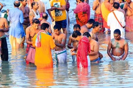 HARIDWAR, INDIA - JANUARY 14, 2016: Devotees taking holy dip at Har Ki Pauri on river Ganga on the first bath of Ardh Kumbh fair. People took a dip in holy Ganges on the occasion of Makar Sankranti