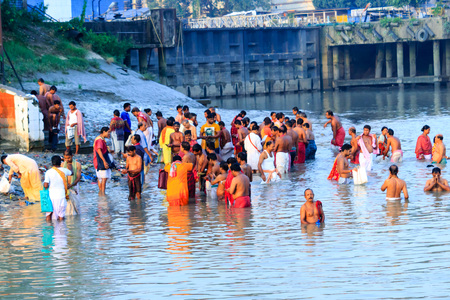 KOLKATA, INDIA - JANUARY 14, 2016: Devotees taking holy dip at Har Ki Pauri on river Ganga on the first bath of Ardh Kumbh fair. People took a dip in holy Ganges on the occasion of Makar Sankranti Editorial