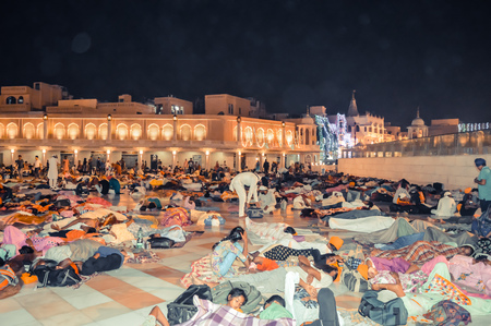 Amritsar, India - MAY 16 2016: People sleeping on the floor of of the Sikh Golden Temple in Amritsar, India.