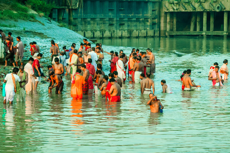 HARIDWAR, INDIA - JANUARY 14, 2016: Devotees taking holy dip at Har Ki Pauri on river Ganga on the first bath of Ardh Kumbh fair. People took a dip in holy Ganges on the occasion of Makar Sankranti