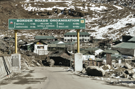 Traffic directional sign board on highway in the entrance of the city near India China border near Nathu La mountain pass in the Himalayas which connects Indian state Sikkim with China's Tibet Region