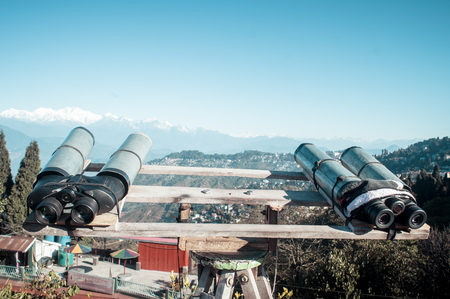 Telescopes, Binoculars, field glasses mounted for viewer to magnify (binocular vision) to see Kanchenjunga, Everest, Annapurna mountain range of distance area. Military tool used for surveillance.