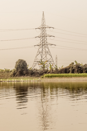 A transmission tower or power tower (electricity pylon or electric pylon in the United Kingdom, Canada and parts of Europe) tall structure, a steel lattice tower, used to support overhead power line.