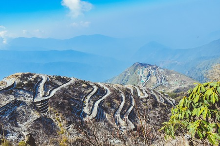 Rugged terrain of lower Himalayas in East Sikkim, Zuluk or Dzuluk, from Thambi View Point. Winding road of 32 hairpin turns. Historic Silk Route from Tibet to India. Offbeat destination in East Sikkim