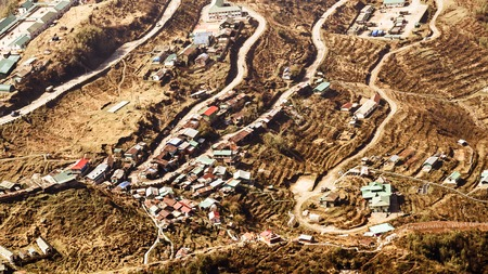 The historic Silk Route with 32 hairpin turns, a winding road from Tibet to India. Located at a height of around 10,100 feet on the rugged terrain of lower Himalayas in East Sikkim, Zuluk or Dzuluk.