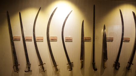 Red Fort Museum of Arms and Weapons, New Delhi, Jul 21, 2018: Arms and Weapons Showcased here in Galleries includes Arrows, Swords, Revolvers, Machine Guns, Shells, Daggers Ivory and Battle Axes.