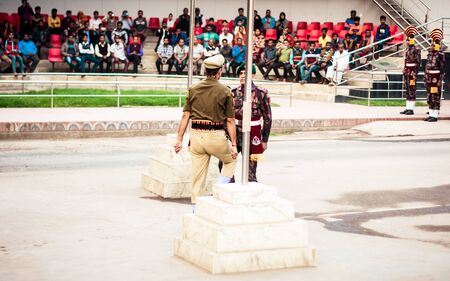 Petrapole-Benapole, Bangaon, 5th Jan, 2019: Joint Retreat of lowering of national flags Ceremony, a military show as Wagah Border with soldiers of Border Guard Security Force of India and Bangladesh. Editorial