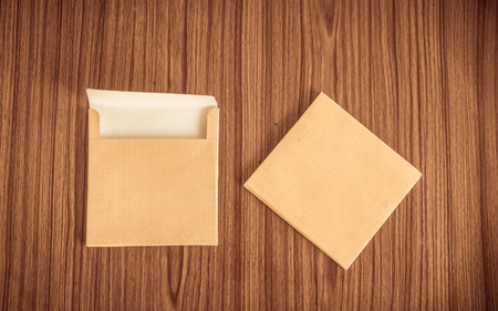 Set of two Brown envelope front and back isolated on wooden table hardwood floor background. Business cards blank. Mockup. Top high angel view object with clipping path. Flat Lay. Copy space for text