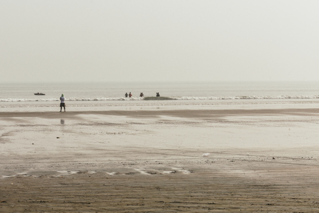 Panoramic view of Ganpatipule Sea Beach, Maharashtra. Ganpatipule has a grand shore, one of the most spectacular on Konkan coast, distinctive red sand and shallow water, making it ideal for swimming. Stock Photo