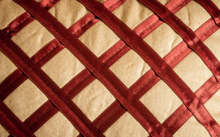 Close up Abstract of silk or satin fabric background of linen cloth textile of red fabric with crisscross diagonal pattern for any occasion. Natural canvas. Studio shot with copy space room for text. Stock Photo